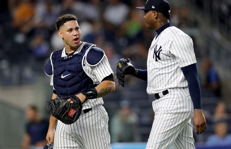 Aroldis Chapman and Gary Sanchez talk following a win on July 27 2017 at Yankee Stadium.
