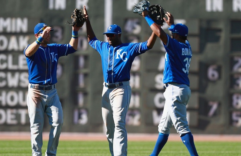 The Royals outfield celebrates a win.
