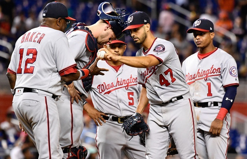 Gio Gonzalez #47 of the Washington Nationals gives the ball to Dusty Baker #12 after giving up a no hitter.