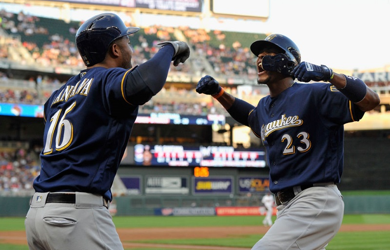 MINNEAPOLIS, MN - AUGUST 07: Domingo Santana #16 of the Milwaukee Brewers congratulates teammate Keon Broxton #23 on a solo home run against the Minnesota Twins during the third inning of the game on August 7, 2017 at Target Field in Minneapolis, Minnesota.