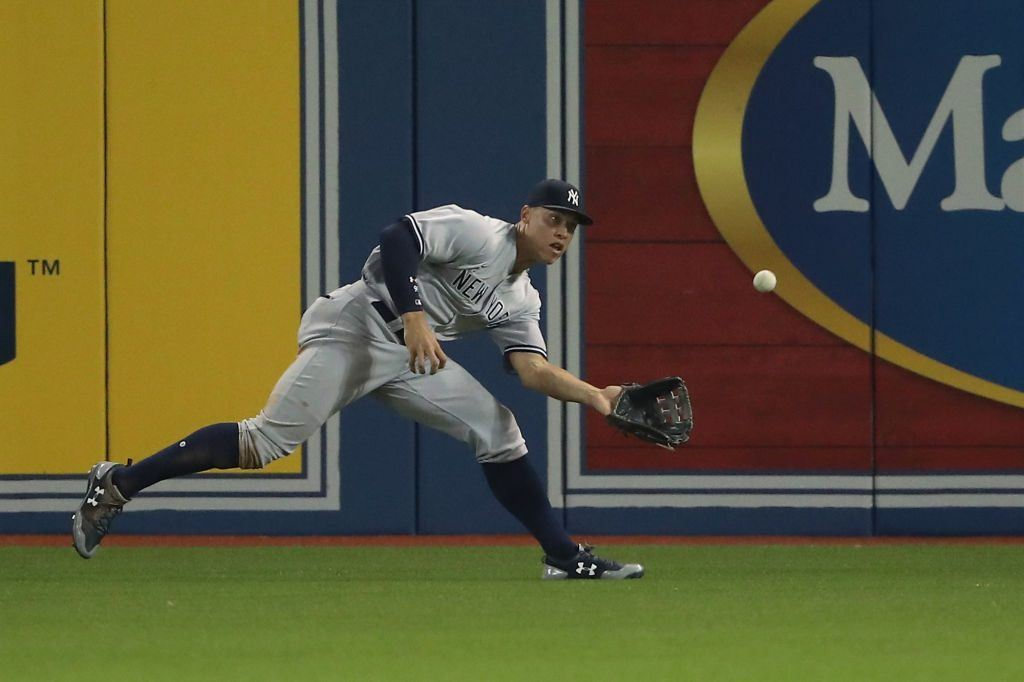 Aaron Judge #99 of the New York Yankees makes a running shoestring catch.