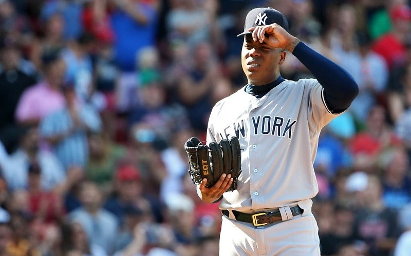 Aroldis Chapman squints during a sunny day at Fenway Park.