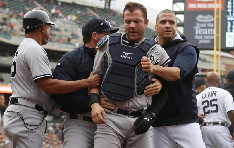 Victor Martinez and Austin Romine during the fight at Comerica Park