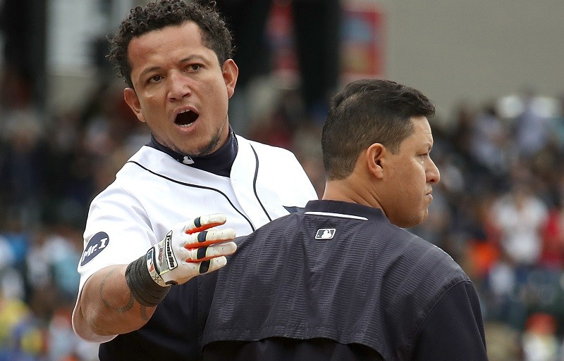 DETROIT, MI - AUGUST 24: Miguel Cabrera #24 of the Detroit Tigers is held back during a sixth inning bench clearing fight with the New York Yankees at Comerica Park on August 24, 2017 in Detroit, Michigan.