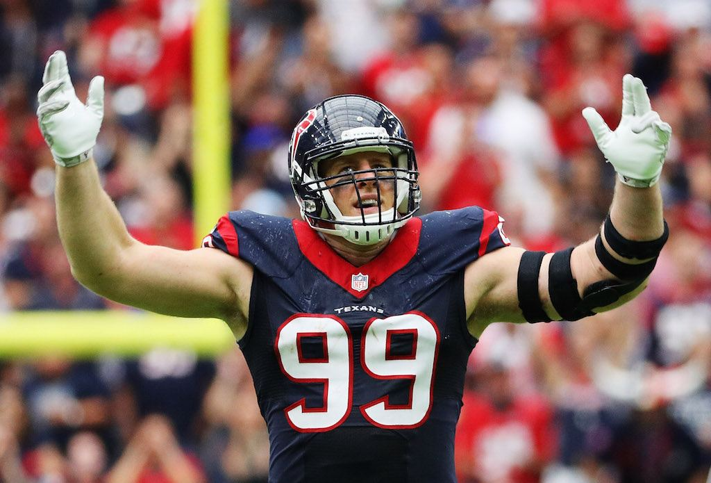 J.J. Watt raises his arms between plays.