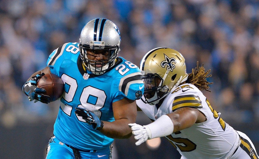 Jonathan Stewart carries the ball.