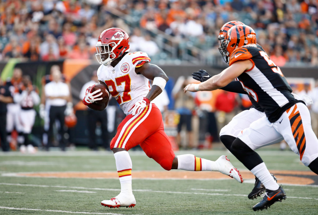 Kareem Hunt #27 of the Kansas City Chiefs runs with the ball