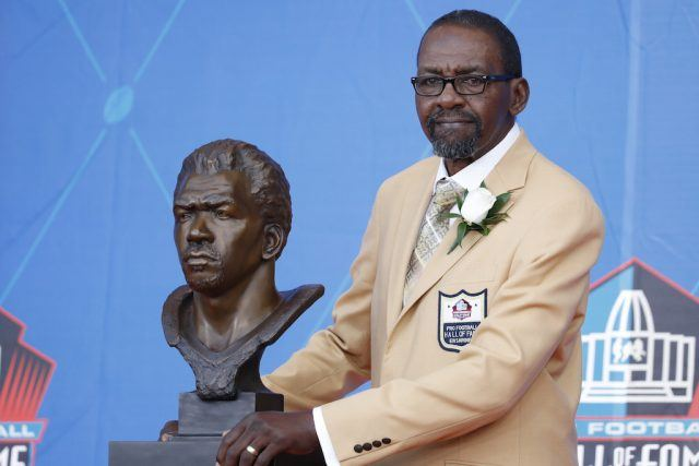 Kenny Easley poses with his bust.