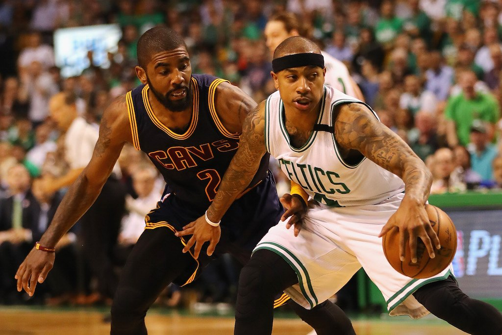 Kyrie Irving goes for the steal against Isaiah Thomas.