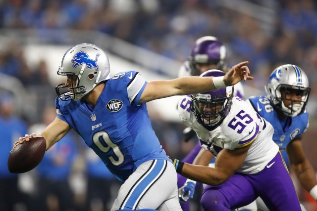 Matthew Stafford scrambles away from pressure.