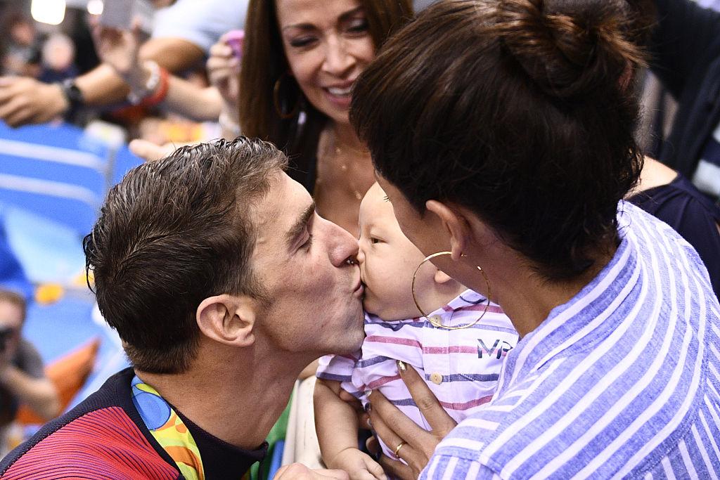 Michael Phelps kisses his son