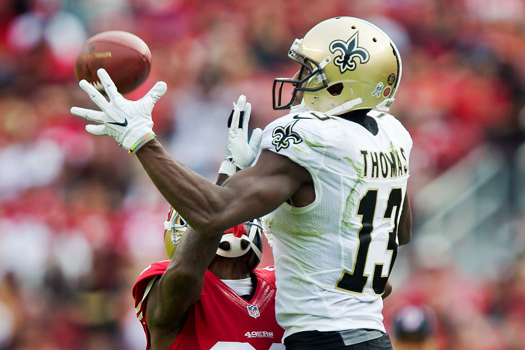 Wide receiver Michael Thomas of the New Orleans Saints tries to pull in a pass against the San Francisco 49ers.
