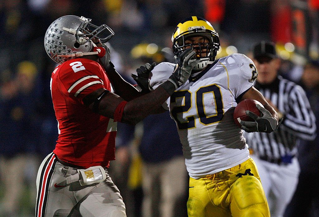 Mike Hart of the Michigan Wolverines stiff arms Malcolm Jenkins of the Ohio State Buckeyes.