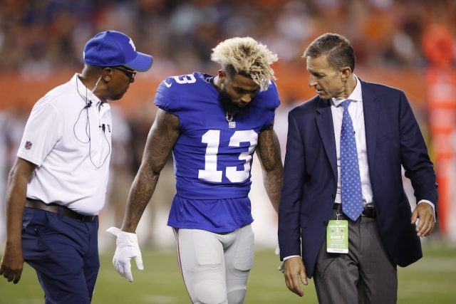Odell Beckham Jr. walks off the field after getting injured in the preseason.