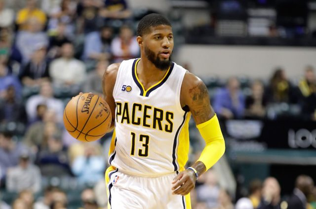 Paul George brings up the ball.