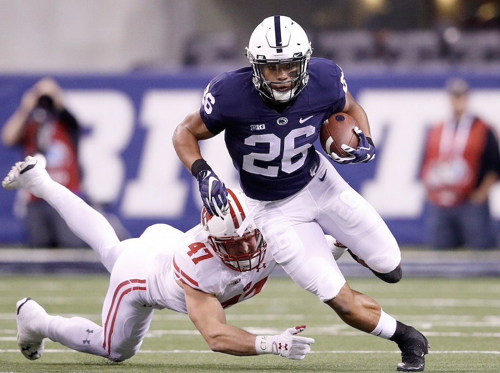 Saquon Barkley carries the ball against Wisconsin.
