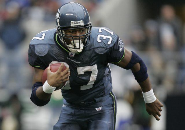 Shaun Alexander carries the ball.