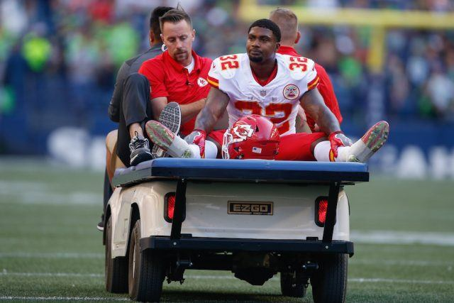 Spencer Ware is carted off the field.