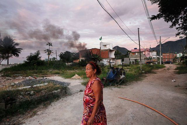 Resident Marize do Amor Divino, who said she was diagnosed with the Zika virus two weeks ago, walks in the mostly demolished Vila Autodromo favela community Rio de Janeiro, Brazil.