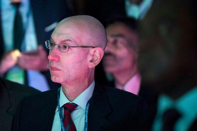 National Basketball Association (NBA) commissioner Adam Silver listens