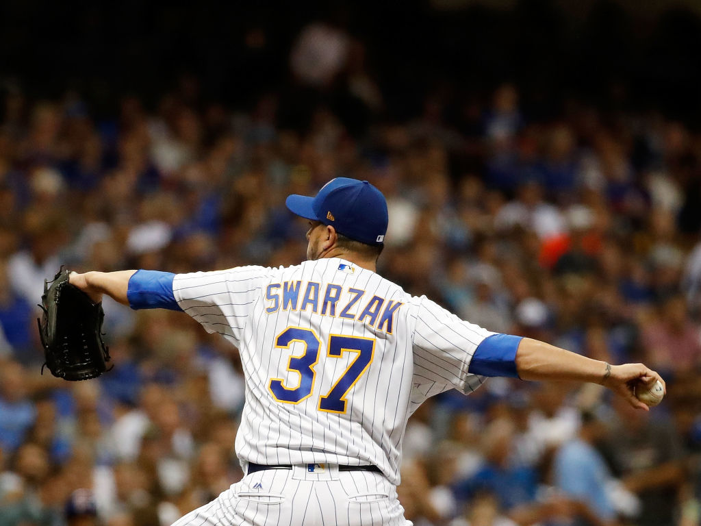 Anthony Swarzak of the Milwaukee Brewers throws a pitch during the eighth inning of a game against the Chicago Cubs