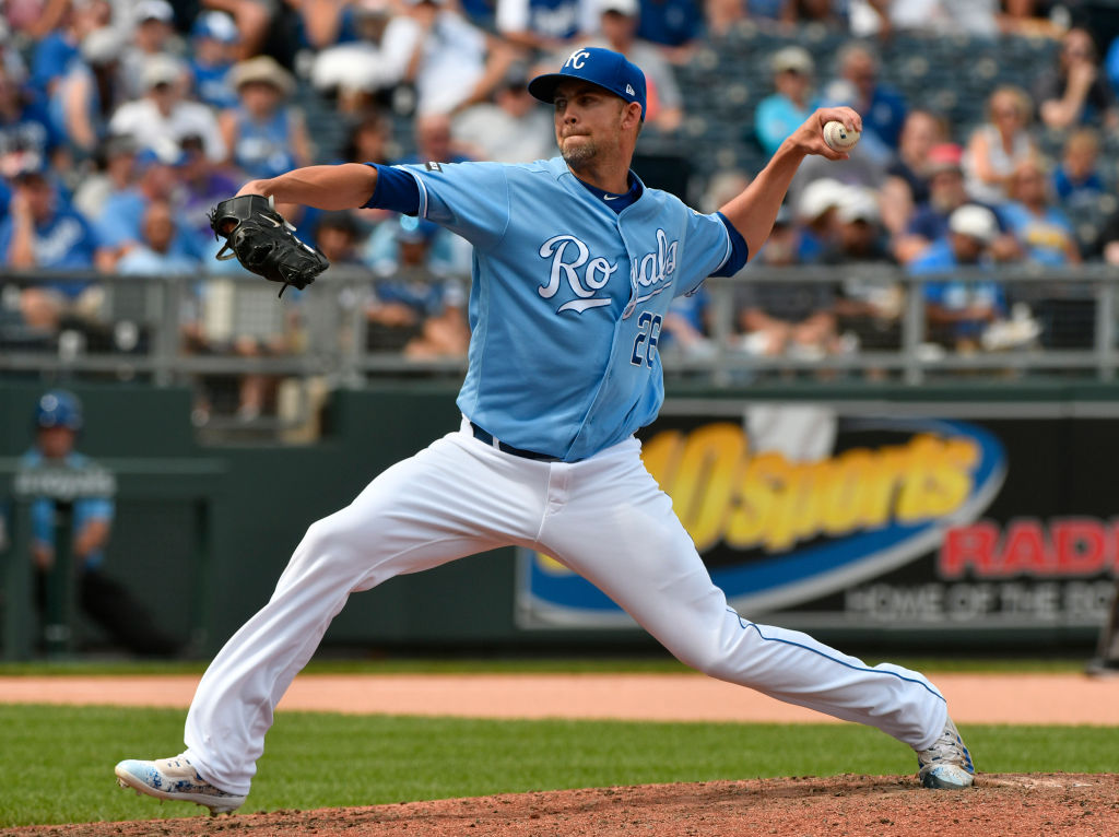 Mike Minor of the Kansas City Royals throws in the eighth inning against the Colorado Rockies.