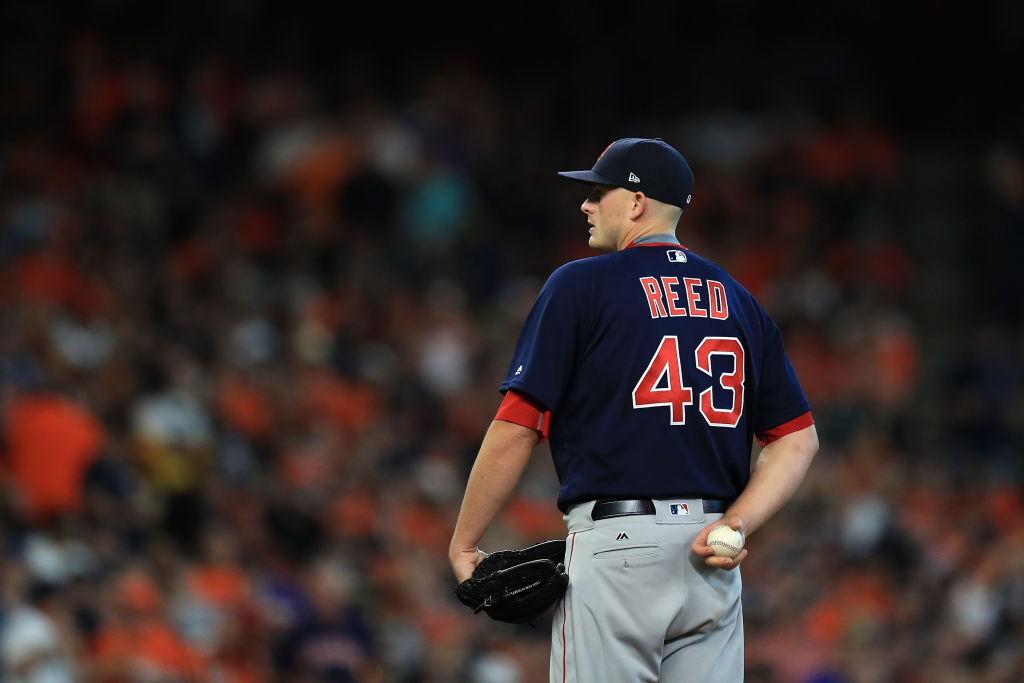 Addison Reed of the Boston Red Sox stands on the pitcher's mound in the sixth inning against the Houston Astros.