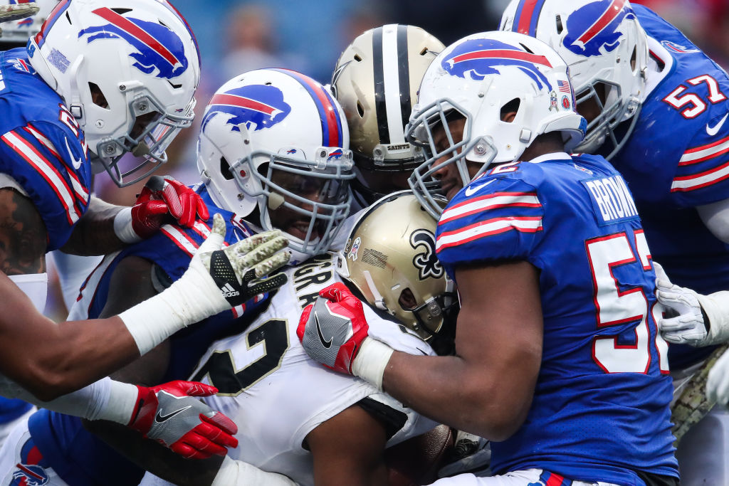 the buffalo bills and saints in a football scrum