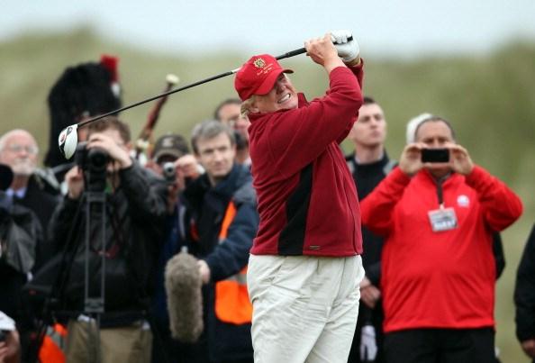trump golfing in abderbeen as the press look on