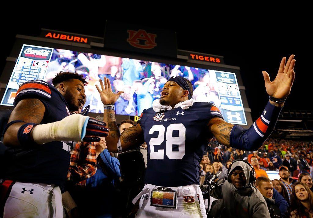 Auburn Tigers Darrell Williams and Tray Matthews celebrate a win at Jordan-Hare Stadium