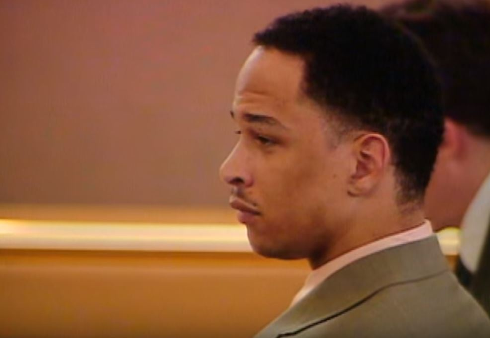 Rae Carruth sits with his lawyers during the trial.