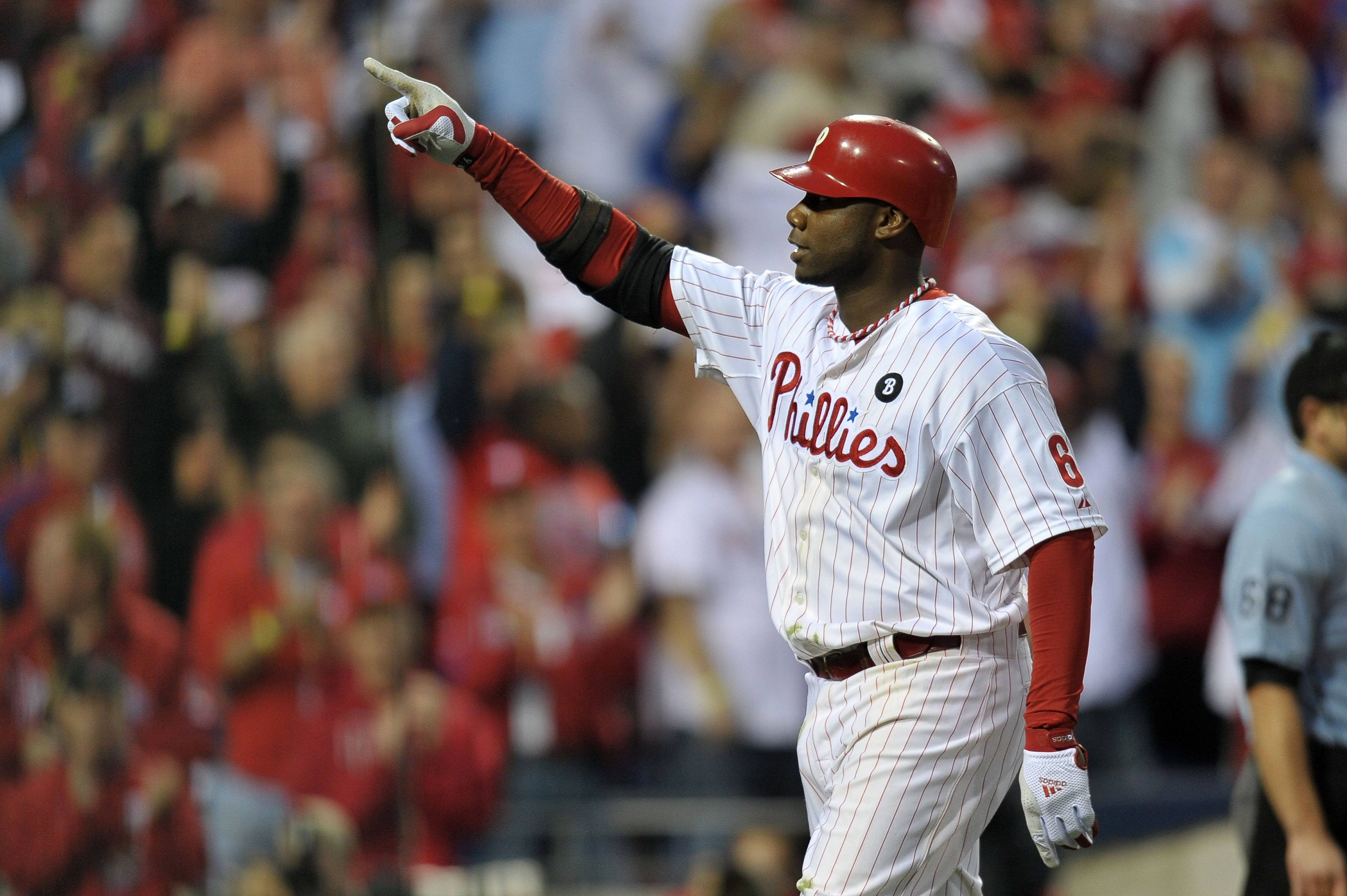 Ryan Howard of the Philadelphia Phillies reacts to hitting a three-run home run.
