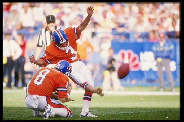 Kicker Rich Karlis of the Denver Broncos kicks the ball during a game against the New England Patriots at Mile High Stadium.