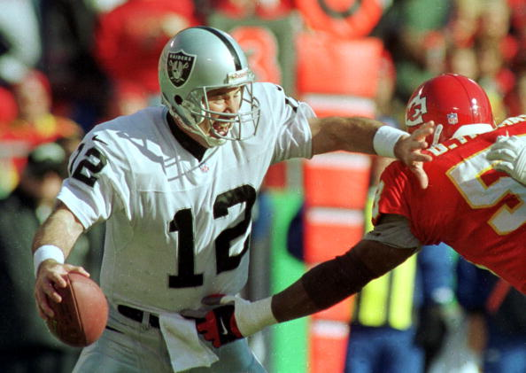 Oakland Raiders quarterback Rich Gannon escapes from the grasp of Kansas City Chiefs' Derrick Thomas.