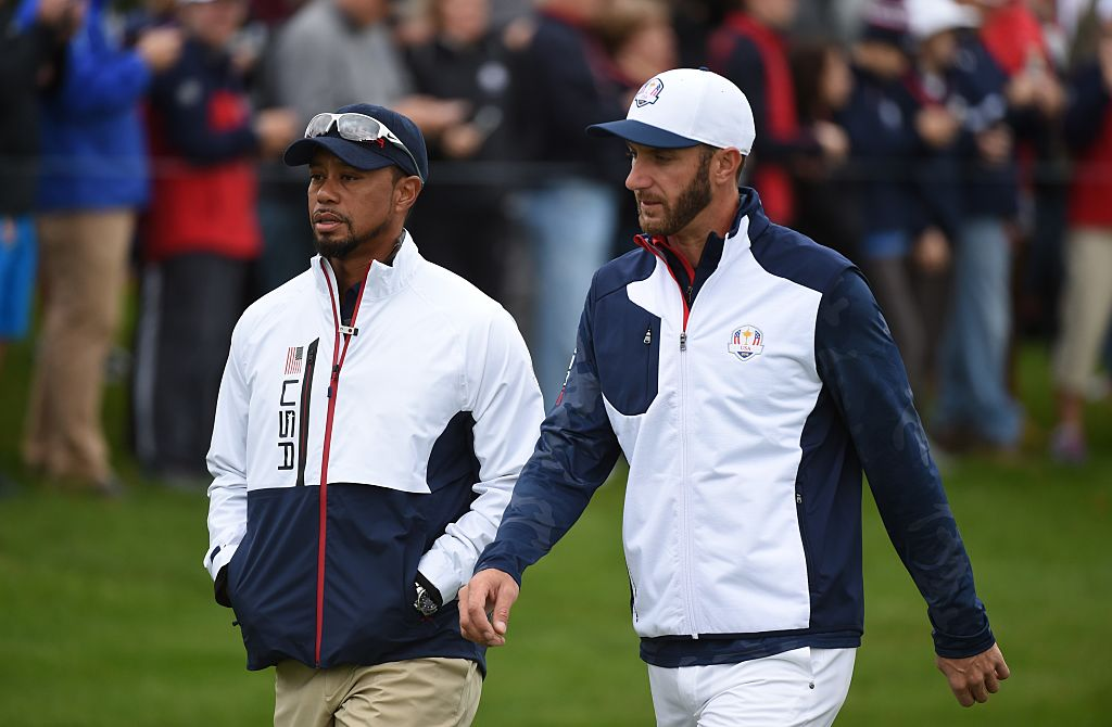 Team USA Dustin Johnson and vice-captain Tiger Woods walk during a practice round ahead of the 41st Ryder Cup at Hazeltine National Golf Course