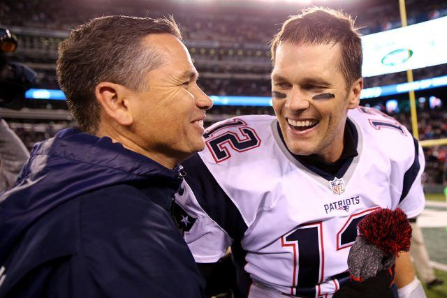 Alex Guerrero pictured on the left of Tom Brady