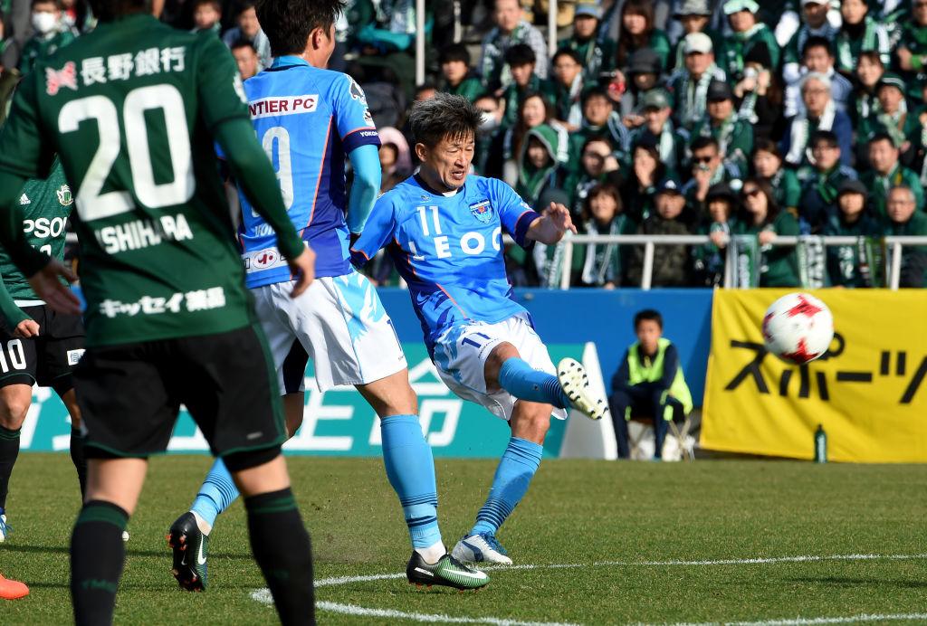Kazuyoshi Miura takes a shot during a game on his 50th birthda