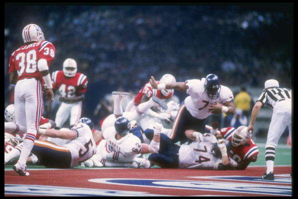 Defensive tackle William Perry #72 of the Chicago Bears dives in for a touchdown during Super Bowl XX against the New England Patriots at the Superdome in New Orleans, Lousiana.