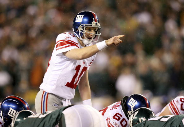 Quarterback Eli Manning of the New York Giants calls a play at the line of scrimmage against the Philadelphia Eagles