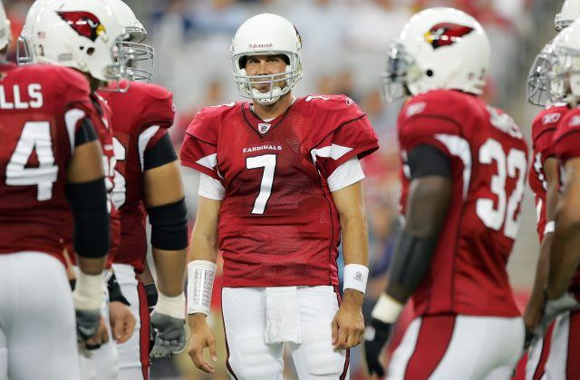 Matt Leinart of the Arizona Cardinals waits with his teammates during a timeout