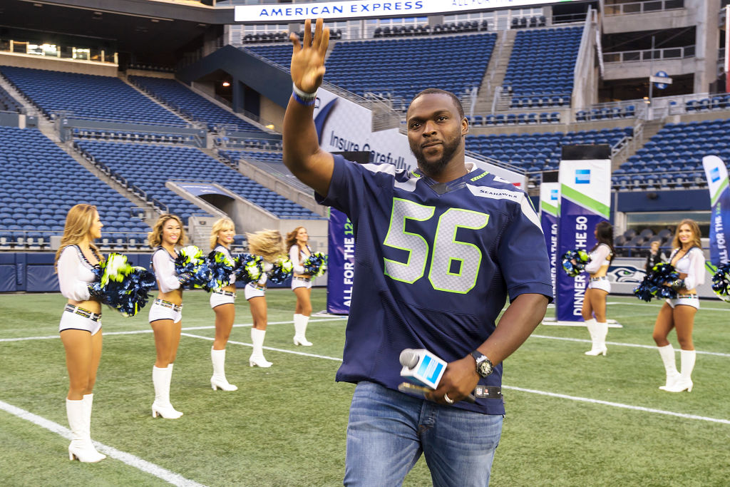 Seattle Seahawks star Cliff Avril waves to the crowd as he enters CenturyLink Field.