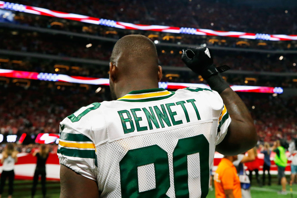 martellus bennett raises a fist during the national anthem