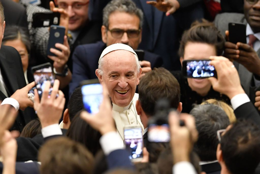 people taking pictures of pope francis on their phones