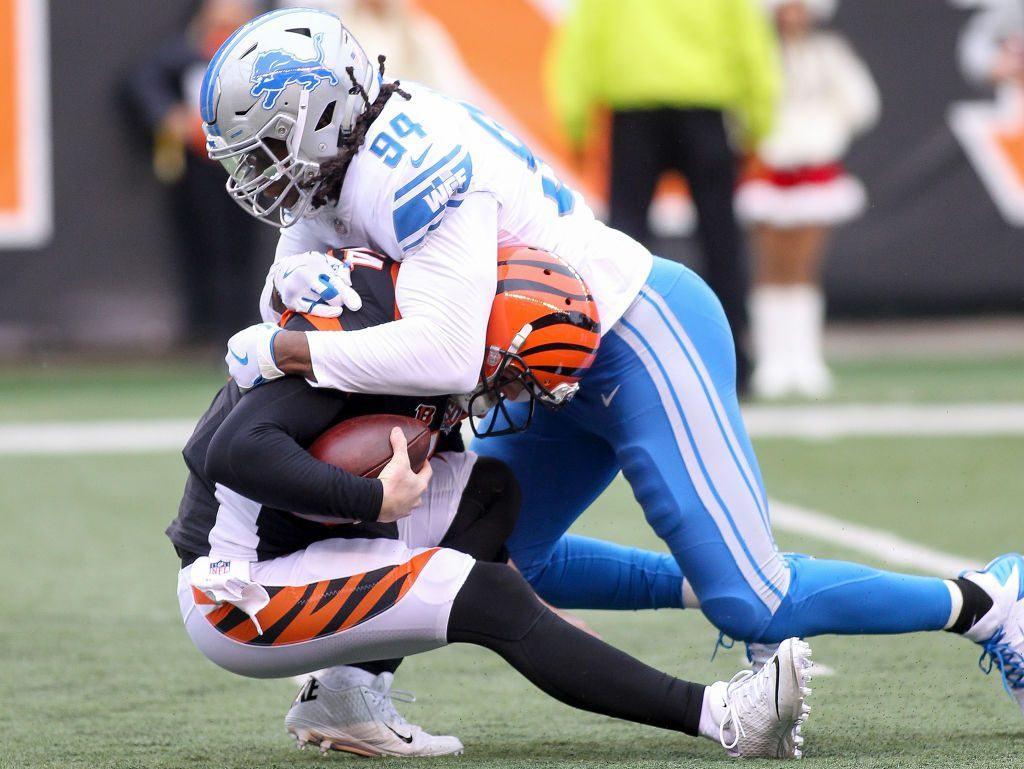 Free Agent Ezekiel Ansah tackling a quarterback.