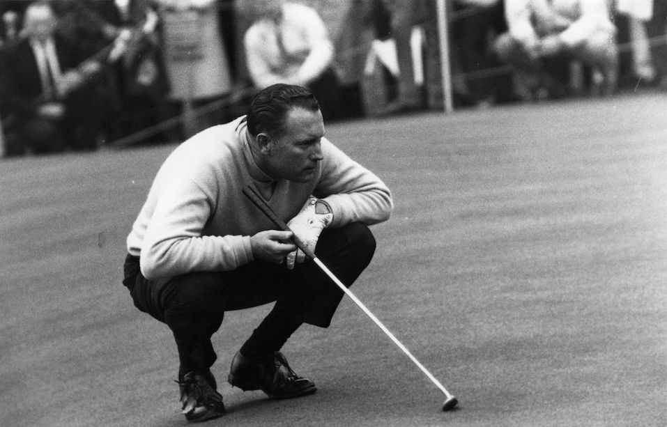 Golfer Billy Casper, who won the 1966 US Open, lining up a put