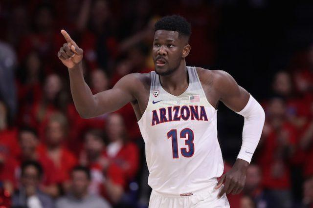 Deandre Ayton pointing ahead while standing on the basketball court.