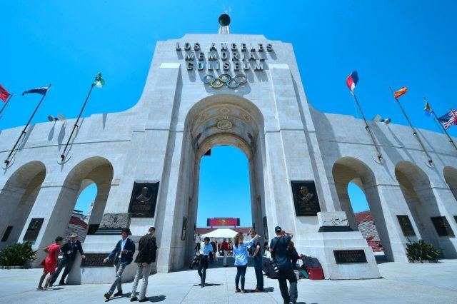 Journalists visit the Los Angeles Memorial Coliseum as the IOC Evaluation Commission continues with its visit in front of the Memorial Coliseum in Los Angeles, California