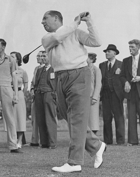Walter Hagen swinging a club