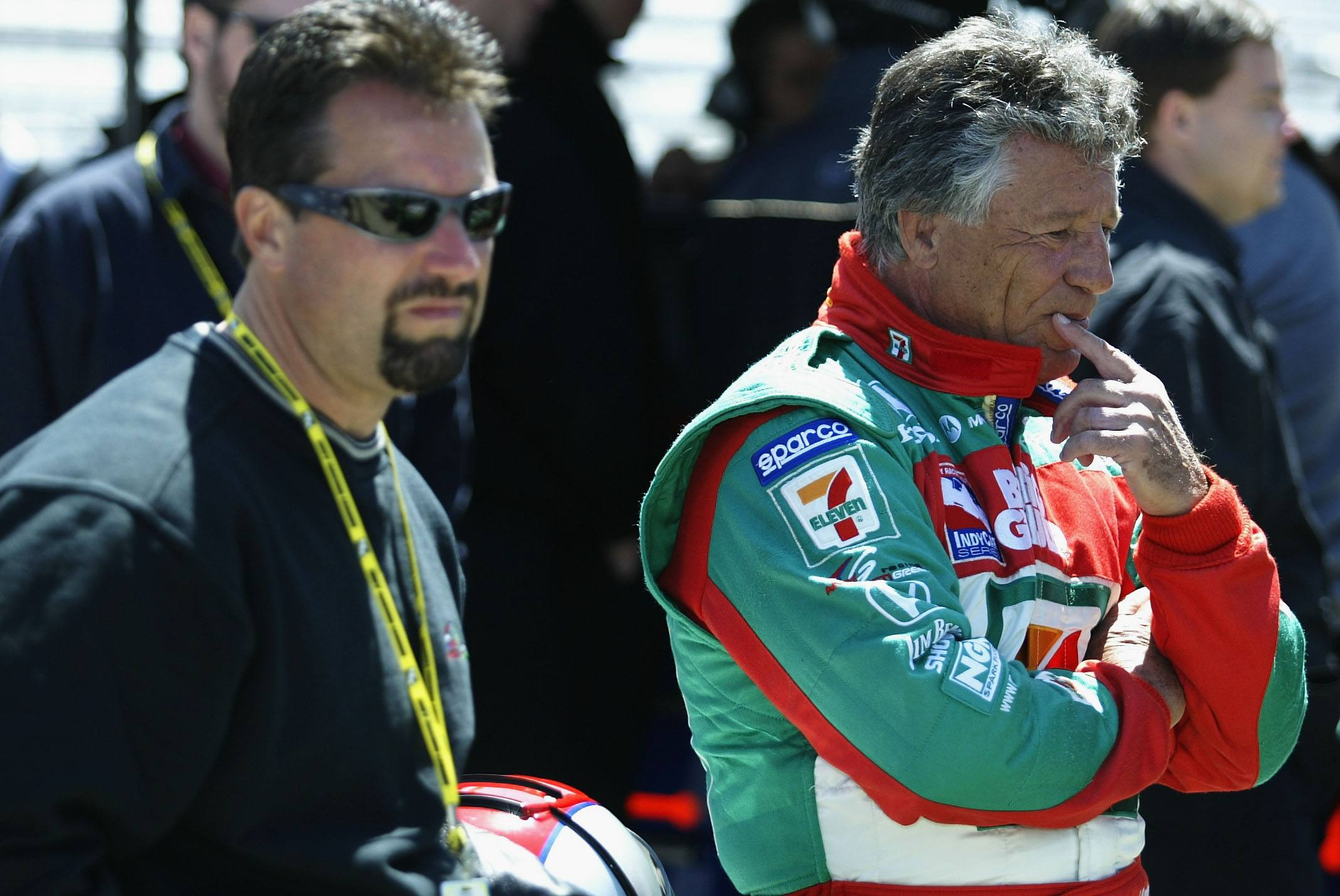 Mario Andretti (right), with his son