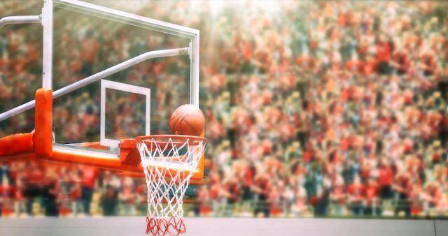 A ball going through a basketball hoop.